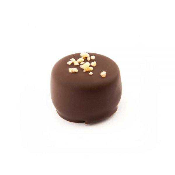 Bombón chocolate negro relleno con ganache de naranja | Pasteleria Fina
