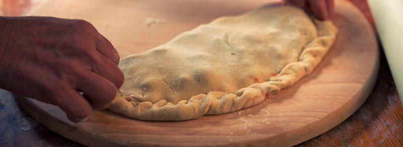 como hacer pizzas dobladas